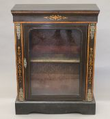 A Victorian inlaid and gilt metal mounted ebonised pier cabinet. 81 cm wide.