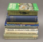 A quantity of various antique reference books.