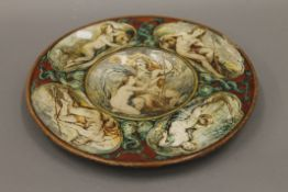 A Maiolica charger, the reverse initialled D.M, dated 1867. 34 cm diameter.