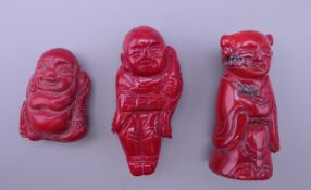 Three coral figures. The largest 5.5 cm high.