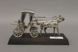 A Maltese silver model of a horse and carriage mounted on a wood base, stamped Handmade,