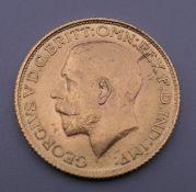 A 1911 gold sovereign.