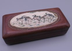 A bone and wooden box decorated with cranes. 11.5 cm long.