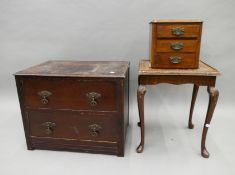 An oak two drawer chest, a side table and a small bank of drawers.