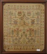 A Victorian sampler worked by Agatha Willis, Aged 9, dated 1849, framed and glazed.