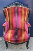 An upholstered armchair. 75 cm wide.