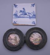 A Delft tile and two 19th century painted plaques. The former 12.5 cm wide.