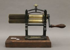 A Victorian warranted crimping machine by T & C Clark & Co. 40 cm long.