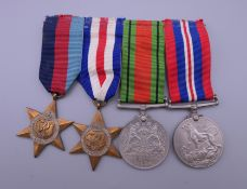 A set of four WWII medals.
