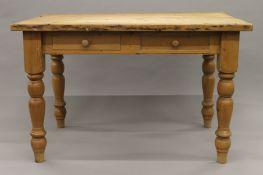 A pine two drawer kitchen table. 121 cm long.