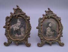 A pair of small brass frames. Each 10.5 cm high.