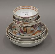 Four 18th century Chinese Export tea bowls and saucers.