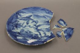 A 17th/18th century Savona Maiolica blue and white dish. 22.5 cm diameter.