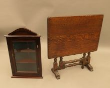 An early 20th century oak folding coffee table and a modern corner cabinet. The former 53 cm wide.