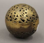 A Chinese brass ball censer. 7.5 cm high.