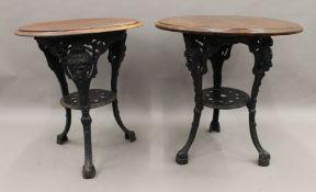 Two maids heads cast iron pub tables. The largest 66 cm diameter.