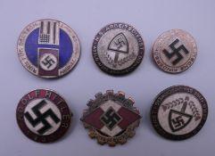 Six Nazi type badges.