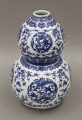 A Chinese blue and white porcelain double gourd vase. 31 cm high.