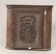 A Victorian carved oak hanging corner cupboard. 76 cm high.