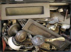 A quantity of doorknobs, etc.
