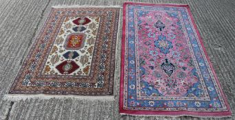 A red ground Persian rug and a white ground Persian rug. The former 186 x 96 cm.