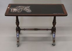 A mahogany coffee table painted with a horse. 81 cm long.