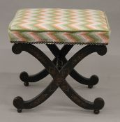 A Victorian chinoiserie x-frame stool. 41 cm wide.