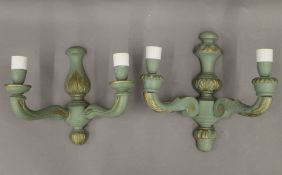 Two painted twin branch wall lights. The largest 28 cm high.