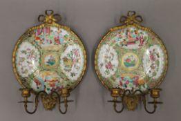 A pair of 19th century Canton plates mounted as girandoles. Each 34 cm high.