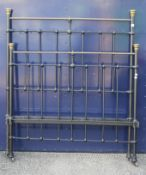 A brass and iron double bed (lacking rails),