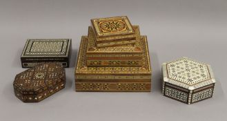 A collection of North African inlaid boxes.