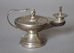 A silver table lighter formed as a lamp. 11 cm long. 112.7 grammes total weight.