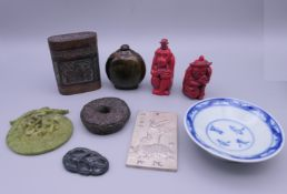 A quantity of small Chinese items, including jade roundels, a horn snuff bottle, etc.