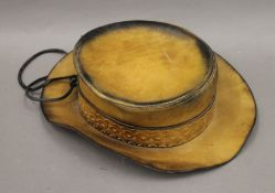 A leather hat. Marked XL - approximate size 7 1/8.