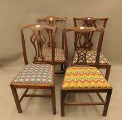 Four Hepplewhite style mahogany dining chairs.