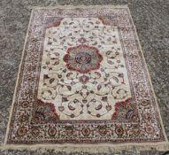 A gold ground full pile Kashmir floral central medallion rug.