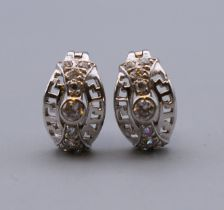 A pair of 9 ct white gold stone set earrings. 1.2 cm high. 2.7 grammes total weight.