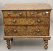 An 18th century and later oyster veneered chest of drawers. 97 cm wide.