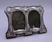 An Art Nouveau style silver double photograph frame. 11 cm wide.