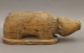 An Indian carved wooden model of a sacred cow. 37 cm long.