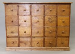 A pine bank of twenty drawers. 137 cm wide.