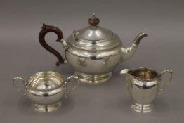 A composite silver three-piece tea set.