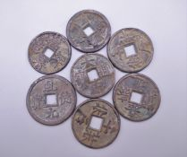 Seven Chinese coins.