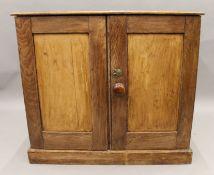 A Victorian pine two door cupboard. 85.5 cm wide.