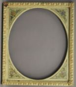 A Continental painted frame with oval mount. 58 x 67.5 cm.