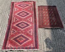 Two red ground runners. The largest 186 x 78 cm.