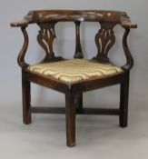 A Georgian mahogany corner armchair. 78 cm wide.