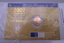 An uncirculated 2002 gold half sovereign.