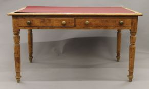 A Victorian pine partners writing table. 135 cm long.