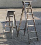 Two vintage wooden step ladders.